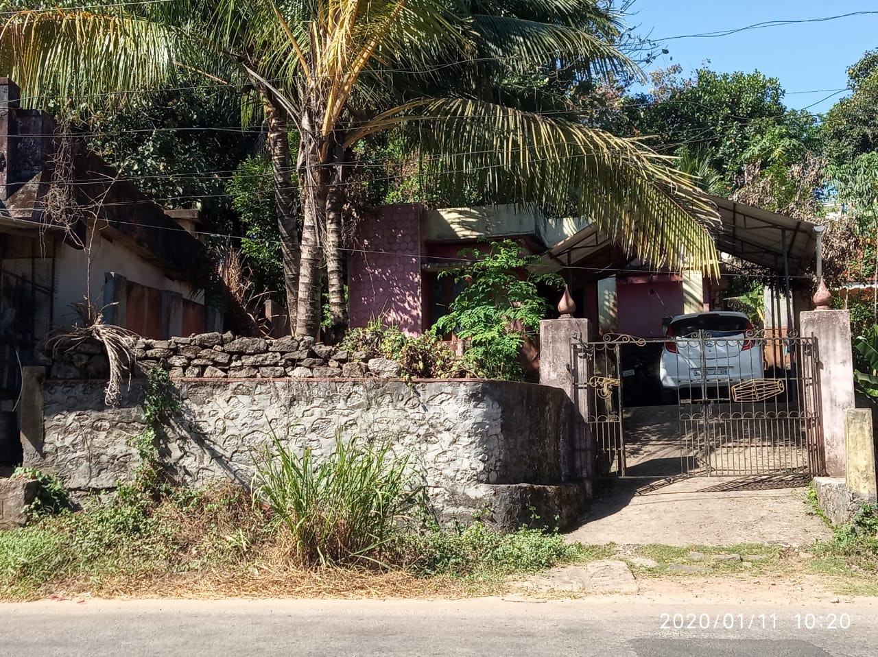 10 cent plot with an old house for sale in kalanjoor main highway side