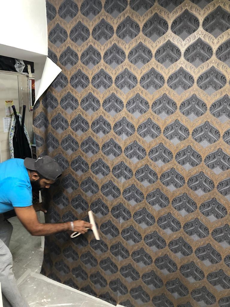 House-office painting /wallpaper decorations electric work and fixings