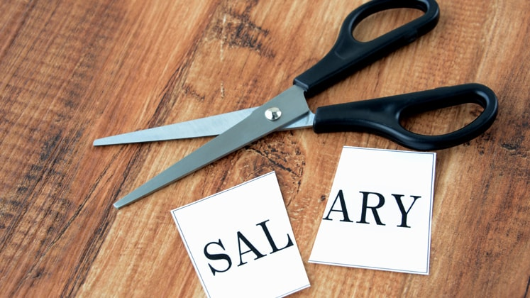Temporary draft law  to allow employers to cut salary up to 50%