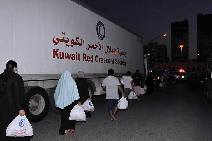 KRCS delivers food aid to workers, residents in Al-Jahra